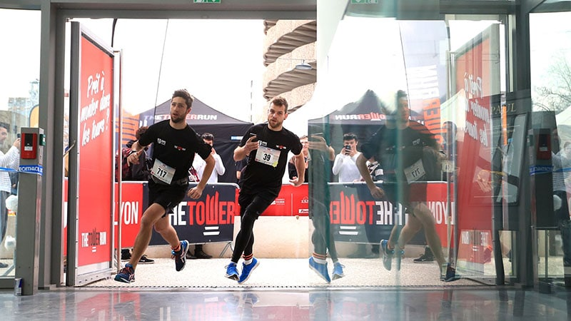athletes entering the lobby of Tour Incity in Lyon