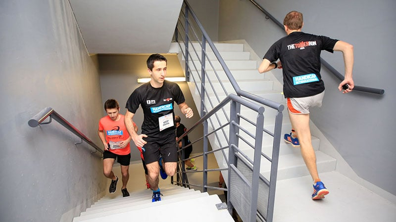 competitors run up floors in tour incity in lyon