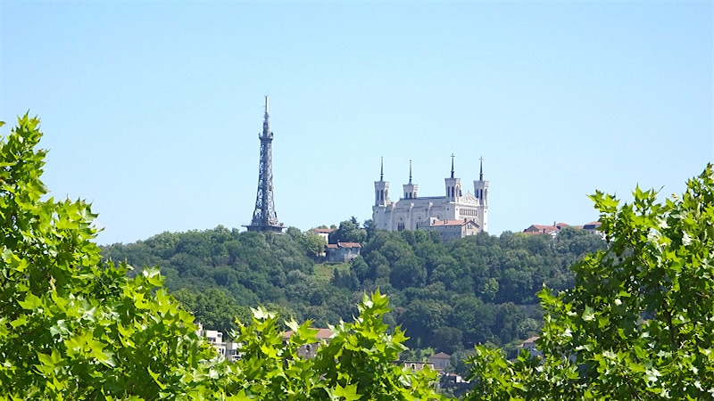 the metallic tower of fourviere behind the hill in the 9th arrondissement